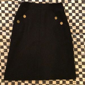 CHANEL black wool skirt with logo buttons; size 34